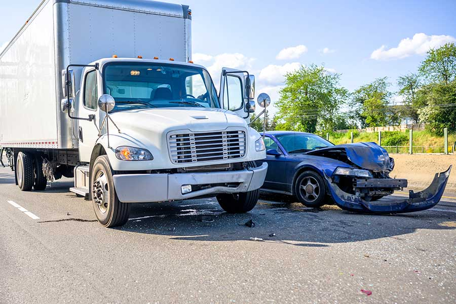 truck slammed into the side of a small car