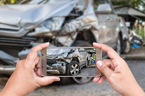 A Rogers uninsured motorist accident lawyer may use your photos as evidence.